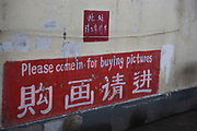 "Shanghai scene, China. A sign on a wall reads ""please come in for buying pictures"""