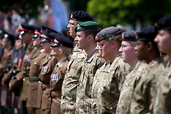 © Licensed to London News Pictures. 30/06/2013. London, UK. Territorial soldiers of the Royal Army Medical Corps stand on parade in Southwark, London, today (30/06/2013) as part of Armed Forces Day celebrations held across the country during the weekend. Units, including City of London Field Hospital Volunteers, The Royal Marines Reserve (City of London), RMR London, The London Irish Rifles: 'D' Company and The London Regiment, all units with connections to the Southwark, were today presented with the freedom of the borough as part of Armed Forces Day celebrations. Photo credit: Matt Cetti-Roberts/LNP