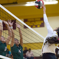 Cougars senior Kaye Dawes (10), attacks at the net as Lishanon Yazzie (9) and Valentina Yazzie (12) attempt to block for Wingate, in Tohatchi on Tuesday.