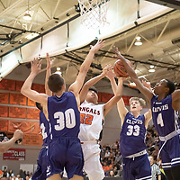 Tyron Barber (22) of Gallup is fouled by Clovis defenders while scoring at the Gallup Invitational held at Gallup High School. Clovis won 64-53.