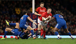 Wales' Hadleigh Parkes runs at France's Mathieu Bastareaud (right) during the NatWest 6 Nations match at the Principality Stadium, Cardiff.