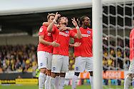 Brighton & Hove Albion centre forward Tomer Hemed (10) scores a goal 1-0 and celebrates during the EFL Sky Bet Championship match between Burton Albion and Brighton and Hove Albion at the Pirelli Stadium, Burton upon Trent, England on 17 September 2016.