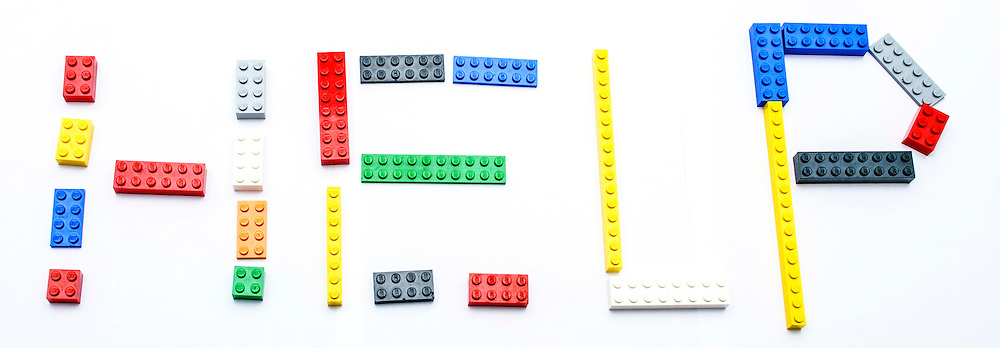 HELP written with a child's colourful building blocks