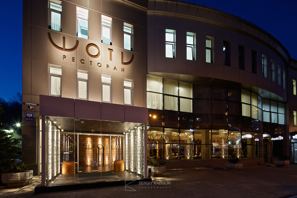 Exterior evening view of georgian restaurant Shoti in Kyiv, Ukraine. Main building and entrance area, as seen during technical opening.
