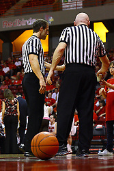 15 March 2012:  Referees Rod Creech and Jeff Cross get some refreshments from the ball girl during a first round WNIT basketball game between the Central Michigan Chippewas and the Illinois Sate Redbirds at Redbird Arena in Normal IL