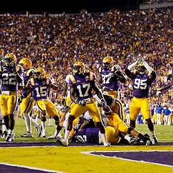 October 16, 2010; Baton Rouge, LA, USA; LSU Tigers players celebrates after forcing a safety against the McNeese State Cowboys during a game at Tiger Stadium. LSU defeated McNeese State 32-10. Mandatory Credit: Derick E. Hingle