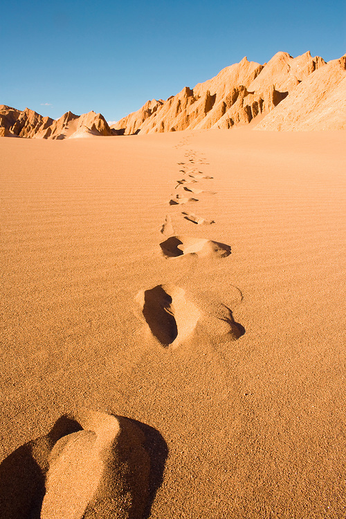 Footprints at Valle de la Muerte (spanish for Death Valley) also known as La Cordillera de la Sal (spanish for salt mountain range), San Pedro de Atacama, Atacama Desert, Antofagasta Region, Chile, South America
