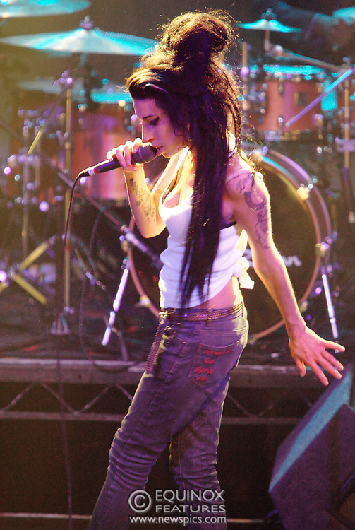 Singer Amy Winehouse, DOB=14/09/1983, performing for her gay fans at the G-A-Y Club. G-A-Y is London's biggest gay club and is held at the London Astoria nightclub, Soho, London, UK. Amy spent much of the show rubbing her itchy nose. She also seemed to have signs of old scars all down one arm...Picture Data:.Photographer: Edward Hirst.Copyright: ©2007 Licensed to Equinox News Pictures +448700 780000.Contact: Equinox Features.Date Taken: 20070415.Time Taken: 020518+0000.www.newspics.com