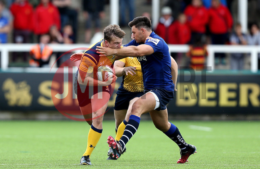 Ted Hill of Worcester Warriors gets past the tackle of Matt Rogerson of Sale Sharks - Mandatory by-line: Robbie Stephenson/JMP - 30/07/2016 - RUGBY - Kingston Park - Newcastle, England - Worcester Warriors v Sale Sharks - Singha Premiership 7s