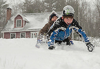 Riley Marsh and Jack Cennamo go sledding during the first big snow storm of the season on Thursday afternoon.  (Karen Bobotas/for the Laconia Daily Sun)