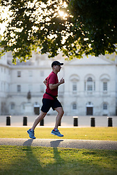 © Licensed to London News Pictures. 25/07/2019. London, UK. A jogger runs past Horse Guards Parade in early morning sunshine and heat in St James's Park in central London Today is expected to be another hot day with record breaking temperatures in parts of the UK  Photo credit: Peter Macdiarmid/LNP