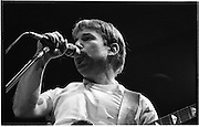 """Paul Simon In Concert.  (R54)..1987..16.04.1987..04.16.1987..16th April 1987..As part of his world tour of """"Graceland"""", Paul Simon took to the stage of the RDS last night. A packed house was treated to songs from his current album as well as some classics from the Simon and Garfunkel catalogue...Image shows Paul Simon introducing a song from his new album """"Graceland"""" on stage at the RDS,Dublin."""