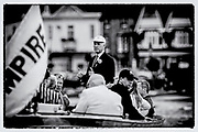 """Henley on Thames,  GREAT BRITAIN, 4 July 2008, Henley Umpire and Steward, Fred SMALLBONE, """"Explaining the Winning Margin"""" to his Guest's, on board, """"ULYSSES"""", after an evening race,  2008 Henley Royal Regatta, on  Friday, Henley on Thames. ENGLAND.,  """"Film Noir Style Photography"""", © Peter SPURRIER,"""