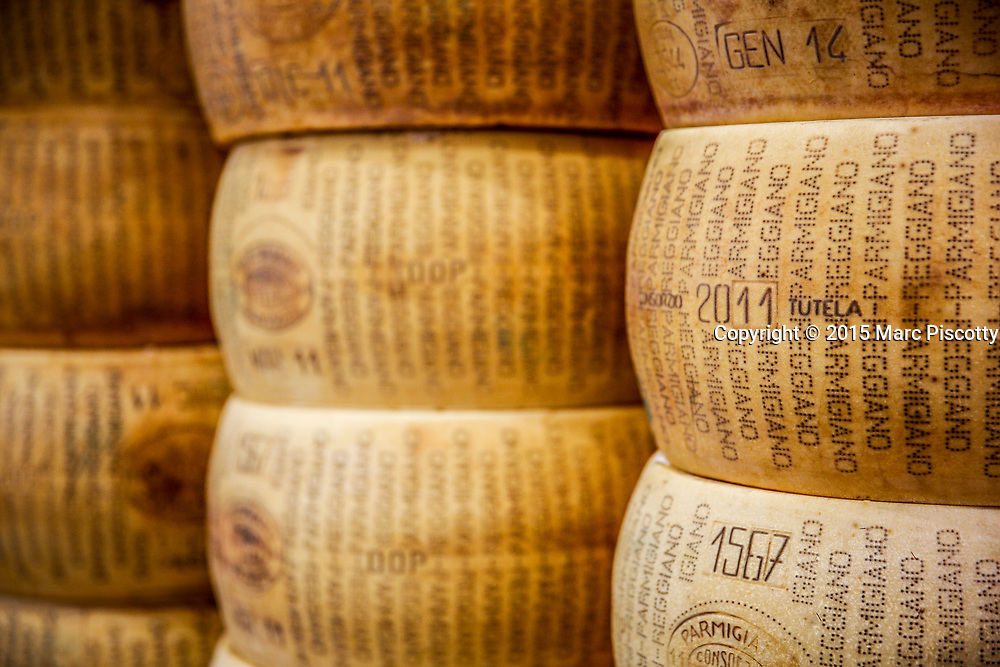 """SHOT 10/16/15 1:04:11 PM - Wheels of Parmigiano-Reggiano cheese for sale at Italy Chicago. Parmigiano-Reggiano is an Italian hard, granular cheese. The name """"Parmesan"""" is often used generically for various simulations of this cheese, although this is prohibited in trading in the European Economic Area under European law. Eataly is a large format/footprint Italian marketplace (food hall) comprising a variety of restaurants, food and beverage counters, bakery, retail items, and a cooking school. Eataly was founded by Oscar Farinetti, an entrepreneur formerly involved in the consumer electronics business, and collaborates with Slow Food. Since 1 October 2016, Eataly has been led by Andrea Guerra, the executive chairman. Many of the stores in the United States are owned through a partnership between celebrity chef Mario Batali and Joe Bastianich. Chicago is the largest city in the US state of Illinois and the third most populous city in the United States, with around 2.7 million residents. Its metropolitan area, sometimes called """"Chicagoland,"""" is the third largest in the United States, with an estimated 9.8 million people within its metropolitan area. Chicago is the county seat of Cook County. Chicago has many nicknames, which reflect the impressions and opinions about historical and contemporary Chicago. The best known include: """"Chi-town,"""" """"Windy City,"""" """"Second City,"""" and the """"City of Big Shoulders. (Photo by Marc Piscotty / © 2015)"""