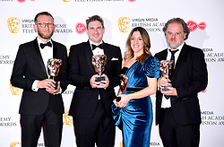 James Newton, Zac Beattie, Georgina Cammalleri and Rupert Houseman in the press room with the award for Single Documentary at the Virgin Media BAFTA TV awards, held at the Royal Festival Hall in London.