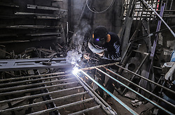 May 1, 2019 - Gaza City, Gaza strip, Palestine - A Palestinian worker working in a mechanical workshop was seen on May 1 on World Workers' Day in Khan Yunis, south of Gaza (Credit Image: © Yousef Masoud/Pacific Press via ZUMA Wire)