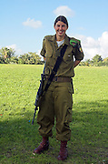 smiling Female Israeli soldier and her rifle