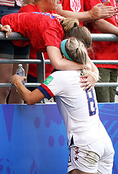 USA's Julie Ertz (right) hugs a family member after the final whistle