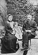 Marie (1867-1934) and Pierre (1859-1906) Curie. With their elder daughter Irene in 1904,