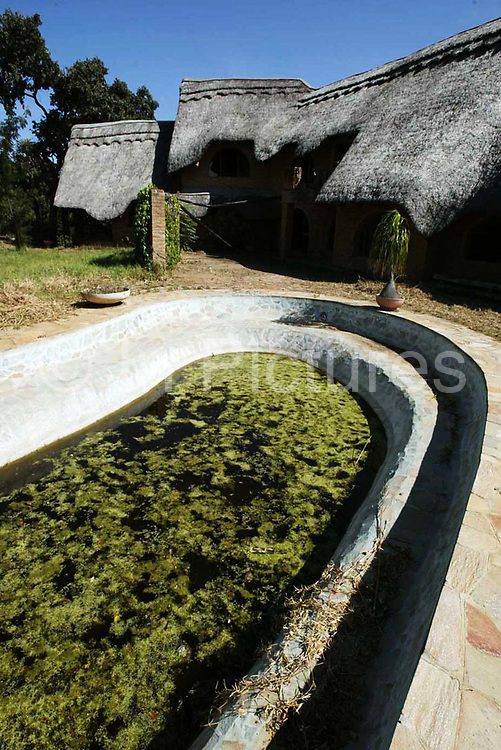 The swimming pool at Maryvale farmhouse which had been looted and destroyed by Zimbabweans trying to oust the local white farmers from Zimbabwe.