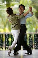 A couple taking dancing lessons at Lumpini Park, Bangkok, Thailand
