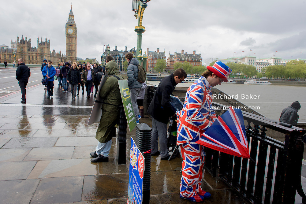 High winds and wet weather herald an uncertain week in the Britain less than 24 hours before the UK's general election. Unlikely prospects for a majority government by the end of the week means stormy deals between political parties and discontent with voters. A tourist leaflet man dressed in union jacks hands out details for a nearby fish and chip business, opposite the Palace of Westminster on Westminster Bridge.