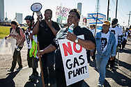 Opponents of Entergy's Natural Gas Power plant in New Orleans East march along River Road in Cancer Alley on March 3, 2018.  The march passed Entergy's Waterford 3 Nuclear Generating Station and  Dows Chemical Plant, ending at the Taft Cemetery.