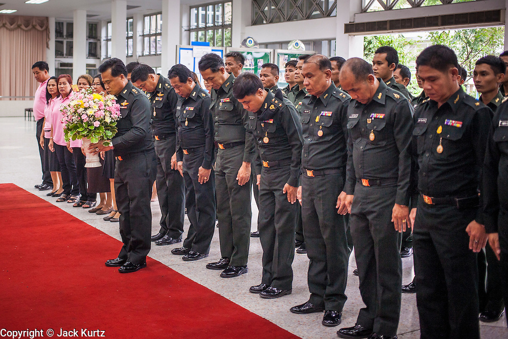 26 NOVEMBER 2012 - BANGKOK, THAILAND:   Military officers make an offering of a gift for the hospitalized King of Thailand at Siriraj Hospital in Bangkok. Siriraj was the first hospital in Thailand and was founded by King Chulalongkorn in 1888. It is named after the king's 18-month old son, Prince Siriraj Kakuttaphan, who had died from dysentery a year before the opening of the hospital. It's reported to one of the best hospitals in Thailand and has been home to Bhumibol Adulyadej, the King of Thailand, since 2009, when he was hospitalized to treat several ailments. Since his hospitalization tens of thousands of people have come to pay respects and offer get well wishes. The King's 85th birthday is on Dec 5 and crowds at the hospital are growing as his birthday approaches. The King is much revered throughout Thailand and is seen as unifying force in the politically fractured country.      PHOTO BY JACK KURTZ