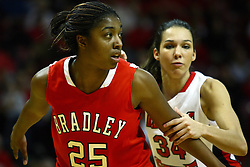 30 December 2010: Latasha Hollingshed blocks out Hannah Spanich during a free shot during an NCAA Womens basketball game between the Bradley Braves and the Illinois State Redbirds at Redbird Arena in Normal Illinois.