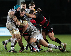 Dragons' Lloyd Fairbrother under pressure from Ospreys' Justin Tipuric<br /> <br /> Photographer Simon King/Replay Images<br /> <br /> Guinness Pro14 Round 12 - Dragons v Cardiff Blues - Sunday 31st December 2017 - Rodney Parade - Newport<br /> <br /> World Copyright © 2017 Replay Images. All rights reserved. info@replayimages.co.uk - http://replayimages.co.uk