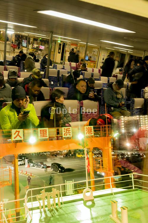 people on the Tokyo-Wan ferry at Kurihama harbor Yokosuka Kanagawa prefecture Japan