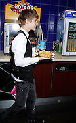 16/02/2011<br /> Justin Bieber Film Prem At The O2<br /> <br /> justin went behind the food and sweet stall and helped himself to a drink and nachos<br /> <br /> ©James Curley/Exclusivepix