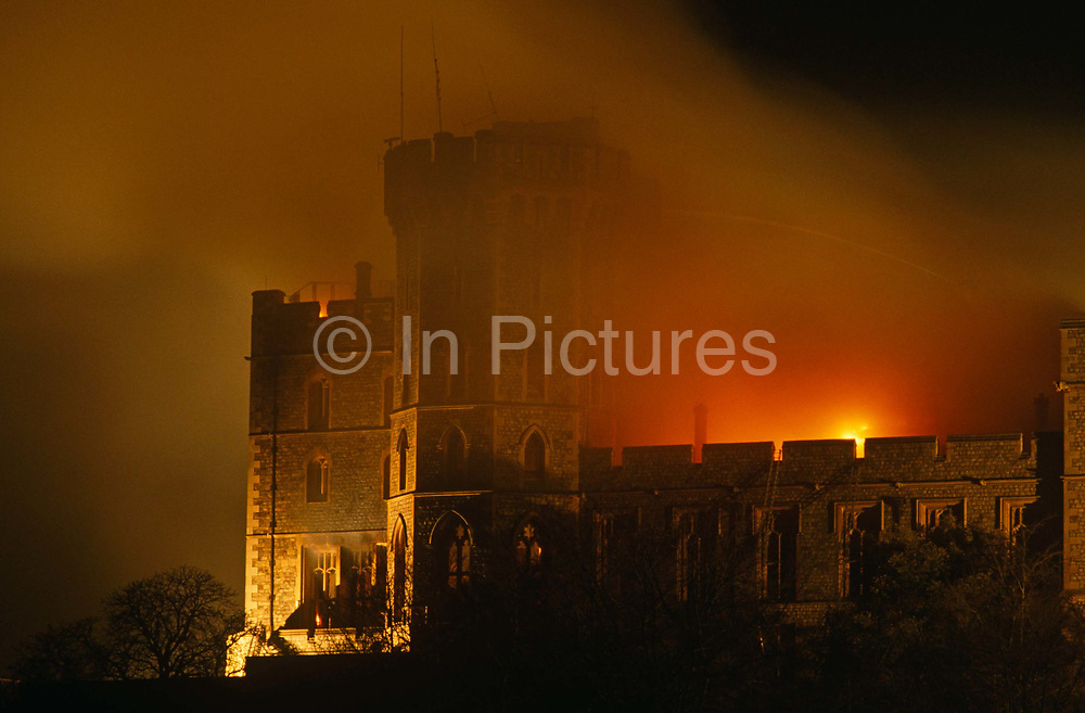 Flames lick the roof of the Queen's private and state apartments in Windsor Castle as smoke darkens further the night sky. We see the most northerly corner of this old building that caught fire in a private chapel on the first floor of the north-east wing. Sprading quickly, damaging St George's Hall, which is often used for banquets. Windsor is the largest inabited castle in the world and partly dates to the time of the Norman King William the Conquerer. In all, one hundred rooms were damaged in the fire and intense public debate was sparked about whether the taxpayer should foot the repair bill, as the castle is owned by the British Government and not the Royal Family. But the Queen agreed to meet 70% of the costs, and opened Buckingham Palace to the public to generate extra funds. The £40m restoration took five years