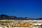 Salt deposits of dried lake bed in desert near Death Valley, California, USA