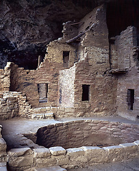 Mesa Verde Cliff Palace, the largest and most famous cliff dwelling in Mesa Verde National Park bullt by the Anasazi centuries ago. It has over 150 individual rooms and more than 20 kivas (rooms for religious rituals). Crafted of sandstone, wooden beams and mortar, Mesa Verde Cliff Palace has been remarkably well preserved from the elements for the past 700 years.  I took this photo in 1986 with my 4X5 view camera.