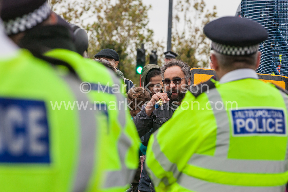 London, UK. 6 September, 2019. Scott Ainslie, Green Party MEP, addresses climate activists taking part in Stop The Arms Fair protests outside ExCel London on the fifth day of a week-long carnival of resistance against DSEI, the world's largest arms fair. The fifth day of protests was themed as Stop The Arms Fair: Stop Climate Change in order to highlight links between the fossil fuel and arms industries.