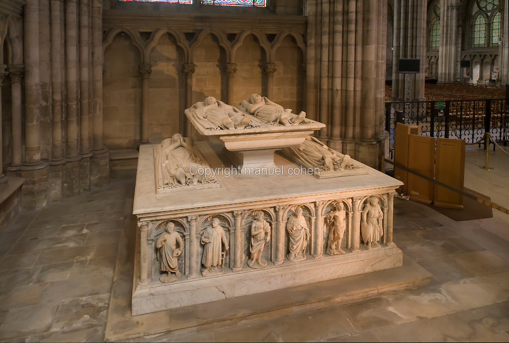 Funerary monument of the Dukes of Orleans, marble, 16th century, with effigies of Louis, Duke of Orleans, 1372-1407, Valentine Visconti his wife, and their sons Charles the Poet, 1394-1465, and Philip, 1396-1420, in the Chapelle Saint-Michel, in the Basilique Saint-Denis, Paris, France. Statuettes of 24 saints and apostles stand in niches around the tomb, which was commissioned in 1502 by Louis XII and made by Italian artists. This tomb was originally in the Chapelle des Celestins in Paris. The basilica is a large medieval 12th century Gothic abbey church and burial site of French kings from 10th - 18th centuries. Picture by Manuel Cohen