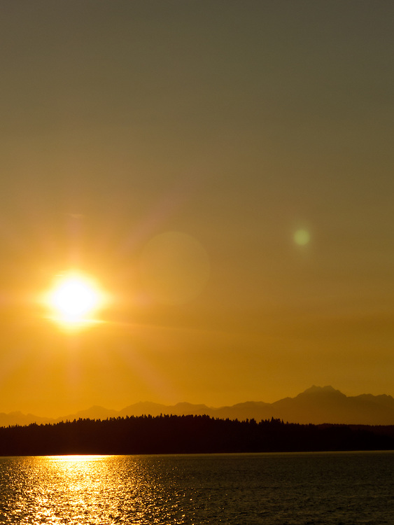 Long light over Puget Sound with the Brothers of the Olympic Mountains to the right.