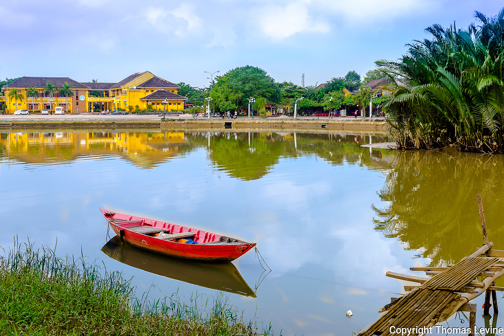 Dec 2018, Hoi An: Red lone red boat in Old Town waterway Hoi An.