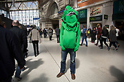 People dressed up in crazy costumes at Waterloo station on their way to the Rugby Sevens tournament. Fans of this sport have developed theeir own tradition of dressing up in costume to support their teams. London, UK.