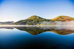 © Licensed to London News Pictures. 02/10/2016. Loweswater UK. Picture shows the mountains reflecting into the still water of Loweswater lake in Cumbria at sunrise this morning. Photo credit: Andrew McCaren/LNP