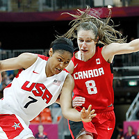 07 August 2012: USA Maya Moore drives past Canada Kim Smith during 91-48 Team USA victory over Team Canada, during the women's basketball quarter-finals, at the Basketball Arena, in London, Great Britain.