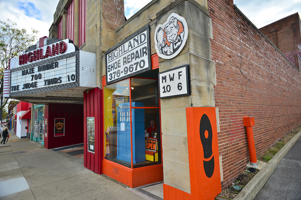 Exterior of Highland Shoe Repair and the Highland Theatre.