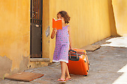 Child comes home from vacation with book in exterior