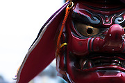 A priest in a demon mask during the Kanamara matsuri, Kawasaki Daishi, Japan April 5th 2009