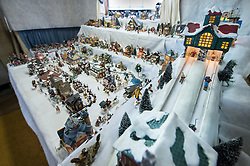 A huge village of miniature buildings and homes are part of the vast collection owned by Mary King of Lakeport.  (Alan MacRae/for the Laconia Daily Sun)