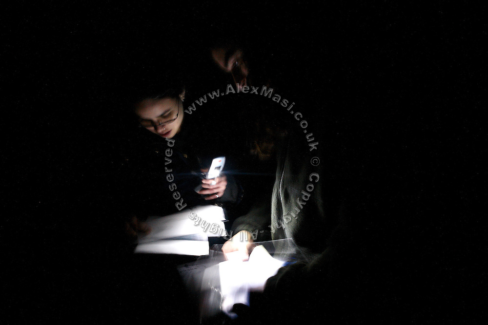 Kitty, 24, (left) from Trinidad, and Josh, 26, (right) from London, are inspecting dates on the letters belonging to the owner of a mansion they have just been able to enter tonight, on Thursday, Oct. 18, 2007, in Hampstead, London, England. The residence, 89 Winnington Road, was former Indonesian President Haji Mohamed Suharto's top London mansion and was sold in 1999 for UK£ 9.5M when he was being investigated in his home country in regards to his fortune and extravagant lifestyle. Million Dollar Squatters is a documentary project in the lives of a peculiar group of squatters residing in three multi-million mansions in one of the classiest residential neighbourhoods of London, Hampstead Garden. The squatters' enthusiasm, their constant efforts to look after what has become their home, their ingenuity and adventurous spirit have all inspired me throughout the days and nights spent at their side. Between the fantasy world of exclusive Britain and the reality of squatting in London, I have been a witness to their unique story. While more than 100.000 properties in London still lay empty to this day, squatting provides a valid, and lawful alternative to paying Europe's most expensive rent prices, as well as offering the challenge of an adventurous lifestyle in the capital.