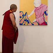 """VENICE, ITALY - JUNE 04:  A Tibetan Monk looks at """"Free Tibet """" a painting by Piergiorgio Baroldi at """"The Pavillion Tibet"""" a project by Ruggero Maggi on June 4, 2011 in Venice, Italy. The Venice Art Biennale will run from June 4 to November 27, 2011."""