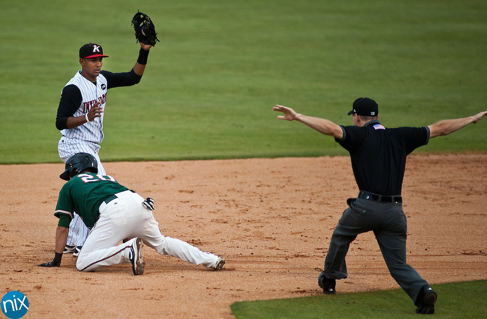 Greensboro's Brent Keys is called safer at second as Kannapolis' Garis Pena shows off the ball in his glove Monday night at CMC-NorthEast Stadium in Kannapolis. The Grasshoppers were leading the Intimidators 3-0 when the game was suspended in the 5th inning do to rain. (photo by James Nix).