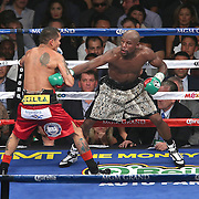 LAS VEGAS, NV - SEPTEMBER 13: Marcos Maidana (L) holds Floyd Mayweather Jr's arm during their WBC/WBA welterweight title fight at the MGM Grand Garden Arena on September 13, 2014 in Las Vegas, Nevada. (Photo by Alex Menendez/Getty Images) *** Local Caption *** Floyd Mayweather Jr; Marcos Maidana